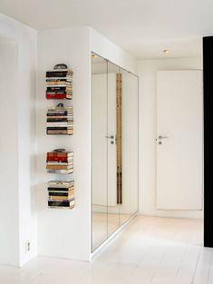 Books on wall (@ loft apartment in Oslo) Outside House Decor, Utility Room Storage, Sliding Wardrobe Doors, Sliding Doors, Coastal Living Rooms, Bedroom Wardrobe, Dream Apartment, Wardrobe Design, Home Furniture