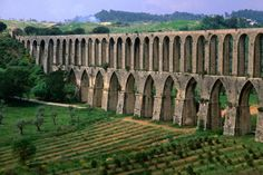 The 17th century Aqueduto de Pegoes with 180 arches was designed to carry water to Convento de Christo. Portugal