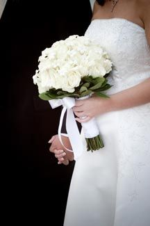 Crisp Pure White Flowers Are Ideal For The Clic Bride