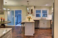 Traditional Kitchen with Raised panel, MS International Persa Cream Granite, U-shaped, Livingston Cabinetry, Limestone Tile