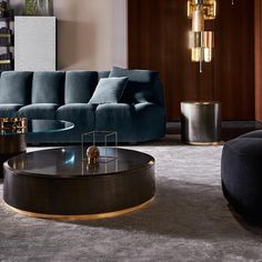Into this living room designed via , style meets opulence and every decor in the room is a testament to a luxurious lifestyle. The dark blue Sofa with the wooden decor goes perfectly well making it look royale. Bureau Design, Salon Design, Best Interior Design, Interior Design Inspiration, Soho, Eames, Muuto, Kartell, Wooden Decor