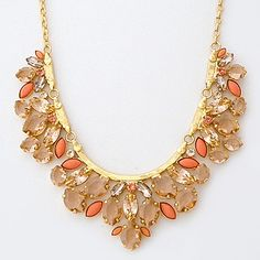 Sorrelli Caribbean Coral Collection. Statement necklace in champagne crystals with accents of coral. Think resort, tropics, destination.