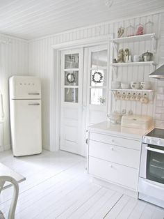 Lovely #shabby #white kitchen with a #smeg!