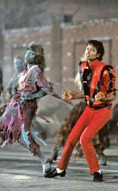 """Michael Jackson, the King of Pop, is cutting a mean rug with his zombie friends in this still-shot from the """"Thriller"""" music video"""