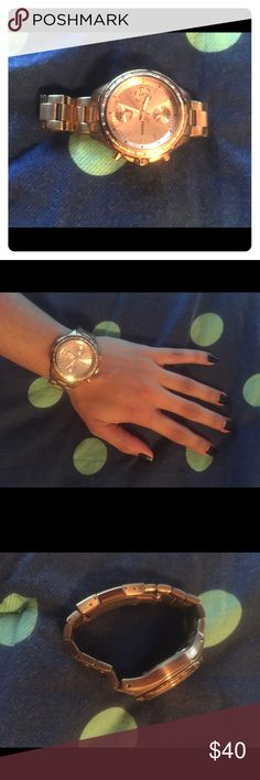 Rose gold fossil watch This watch is in perfect condition. All it needs is a new battery. It is fitted to my wrist, which is rather small, about 5.5 inches in circumference, but if you take it to Fossil, they can add links to make it bigger. Fossil Jewelry Bracelets