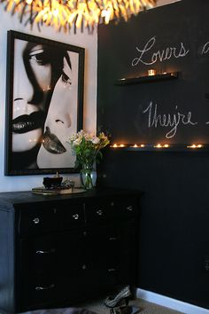 black wall with the candles - i think you should paint the wall behind the shelves black and paint them white
