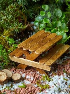 You Can Make This Adorable Fairy Garden Picnic Table Use craft sticks and hot glue to make perfectly-sized furniture for a tiny container garden. The post You Can Make This Adorable Fairy Garden Picnic Table appeared first on Garden Easy. Fairy Garden Furniture, Fairy Garden Houses, Gnome Garden, Garden Homes, Fairies For Fairy Garden, Fairy Houses Kids, Fairy House Crafts, Fairy Garden Cake, Beach Fairy Garden