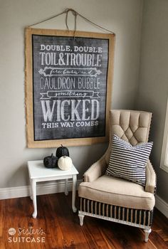 Halloween Chalk Art & DIY Wall Hanging via sisterssuitcaseblog.com #halloween #chalkboard #decor