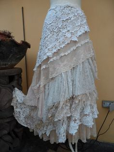 Shes a gorgeous bohemian wrap around vintage inspired skirt kissed with crochet,assorted bridal laces,laces, and embroidered netting in ivory and sand hues and shabby detail with roses where she ties giving her a shabby chic feel.....these pieces are works of art and sell way below their worth so grab something unique while you can!!! looks great worn casually with plain tank or dressed up bohemian style.. 52 across plus long lace ties and belt hole and loop for better fit and due to the…
