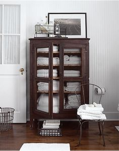 wish I had a cabinet like this for bathroom :( reminds me of the cabin bathroom