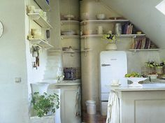 Swedish kitchen... I love how the flowers, plants, and fruit are displayed