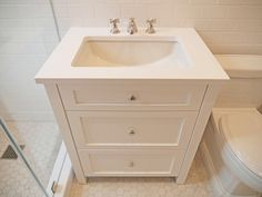 Custom Vanity for Master Bathroom: Complete Apartment Renovation: Complicated by the 100-year old condition, this complete gut renovation included reconfiguring almost everything from the mudroom, open kitchen adding a washer and dryer, upgraded electrical and opened the kitchen/dining room floor plan....