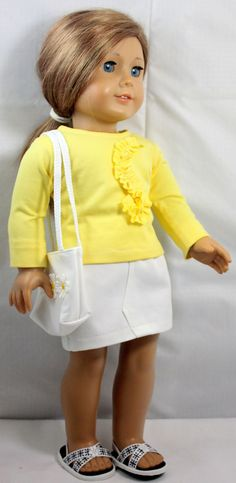 Yellow top with ruffle with white skirt. B & W sandals. (Liberty Jane pattern used for top and skirt)