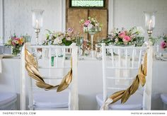 A pretty way to designate Bride and Groom's seats, painted gold magnolia leaves!
