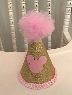 Pink and gold Minnie Mouse birthday party hat. Glitter. Tulle.