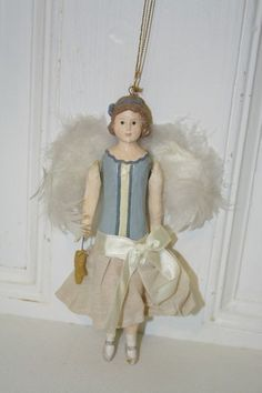 "7 1/4"" Angel figurine ornament with feather wings. Poly/resin. In excellent condition. $8.50"