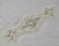 This listing is for: Applique only Quantity: 1 pc rhinestone applique Size: 7.25 inches long and 2.5 inches at the widest part ( see last
