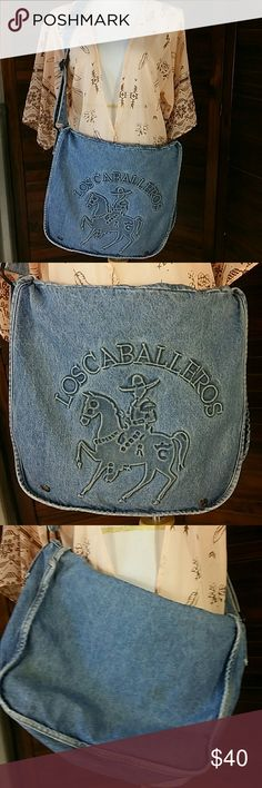"‼️CLEARANCE‼️Denim Los Caballeros Bag ""The Gentlemen"" or ""The Horesemen"" is the translation on this awesome large denim bag.  Design is pressed into the denim.  Distressed/Used look on these is intentional. Two snaps at bottom of front flap.  Two inside front pockets,  one large main area.  Wide adjustable strap can be when short or cross body.  Approx 13"" tall, 17"" across,  4.5"" across bottom.  Strap 1.75"" wide.   Great book bag, diaper bag. Anything bag/purse/tote Bags Shoulder Bags"