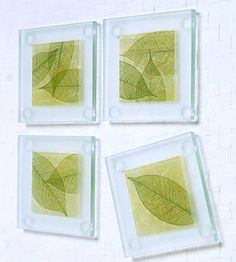 Purchased glass coasters can easily be transformed to promote tranquillity in your home. Textured paper and skeleton craft leaves are decoupaged on the coasters underside, and glass etching enhances the top.