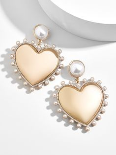 We& head over heels for the Amalia Pearl Heart Drop Earrings. We& head over heels for the Amalia Pearl Heart Drop Earrings. A feminine silhouette is encircled with a pretty swath of crystal, while pearl cab. Heart Shaped Earrings, Gold Drop Earrings, Cute Earrings, Heart Jewelry, Cute Jewelry, Bridal Jewelry, Style Blog, Jewelry Trends 2018, Grunge Jewelry
