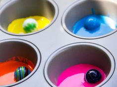 Brilliant!  Love the use of a muffin tin for marble painting.   Painting With Marbles by Moonfrye.com