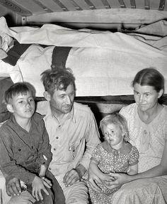 """February 1939. """"White migrant family in trailer home near Edinburg, Texas."""""""