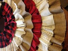 These upcycled and beautiful fabrics give this country tree skirt so much character. From the soft flannel and vintage lace to the burlap upcycled from coffee bean burlap sacks. The print on the backside adds even more charm. Black bows are the perfect country accent to the flannel. Fresh cotton underlayer.  Flannel skirts can be made with either two matching rows of flannel or 2 different flannels. If you check out my pinterest board you can see pics of more of the ones I have made…