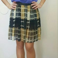 """2 for $10 F21 Pleated Sheer Skirt Black, brown, and cream abstract print pleated skirt with faux leather waist band. It has a built in hot pants as shown in pic 3 (right). Zipper on the left side.  No material tag.  17"""" length 13"""" waist Forever 21 Skirts"""