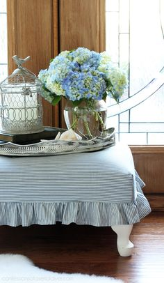 The base and feet were painted in DIY Chalk paint in a mix of Cottage White and Pure White.