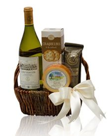 Spring wine gift basket gift easter gift baskets and wine baskets the simple classic wine gift basket a wicker and rope basket filled with a bottle negle Image collections