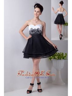 Black and White A-line Sweetheart Prom / Homecoming Dress Organza Appliques Mini-length  http://www.fashionos.com  http://www.facebook.com/quinceaneradress.fashionos.us   An lovely yet sexy prom dress features a sweetheart neckline and a sheathy bodice dotted with crystals. The floral embroidered waistline will make it a lightspot. The contrasting tiers of organza with black hemline on the short skirt give the dress a sassy look.