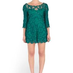 FREE PEOPLE Embroidered Songbird Romper Gorgeous lace romper features sequin embellishments and scalloped edges for a striking look. Round neckline and low-cut back with lower cutout detailing. Button-loop closure with zipper at back. Three-quarter length sleeves. Nipped waist is figure-flattering. Relaxed fit shorts fall at a flirty length. 100% nylon;Lining: 100% polyester;Embroidery: 100% rayon. Dry clean only. Imported. Measurements Inseam: 2 1⁄2 in Free People Pants Jumpsuits & Rompers