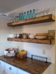 stained floating shelves and counter