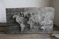 World Map string art, 24x12 is a wonderfully unique wall decor item for the world traveler! Crafted onto barn wood or stained wood with string color of your choice, each piece has its own character and no two are alike. Due to the nature of the barn wood, please allow for a width variation of around an inch. I love for my pieces to fit your needs and personality perfectly- and I am always up for trying new ideas- so please feel free to let me know if this sparks any ideas of your own. I…