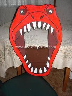 T-Rex throw ball thru mouth game: I used this websites free Dinosaur pictures to create a dinosaur party games for our 5 year old.    Triceratops Dinosaur Homemade Pinata    I made a dinosaur