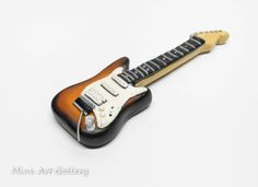 Electric Guitar – musical instruments / polymer clay miniature. © Mini Art Gallery