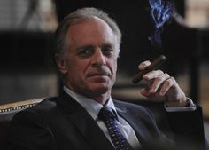 Keith Carradine smoking a cigarette (or weed)
