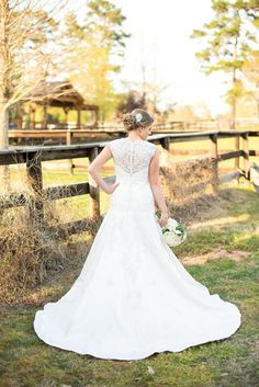 Stunning lace back #weddingdress! Giddy and Gold Photography l Read more http://www.rusticfolkweddings.com/2014/06/24/elegant-rustic-bridal-session-by-giddy-and-gold-photography/