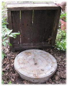 Make shift root cellar out of a galvanized trash can