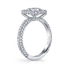 A custom Cushion cut diamond engagement ring set in Platinum exclusively by Jean Dousset.