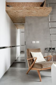 small apartment - loft bed - loft - white - gray - concrete floor - osb - resin floor - vintage armchair