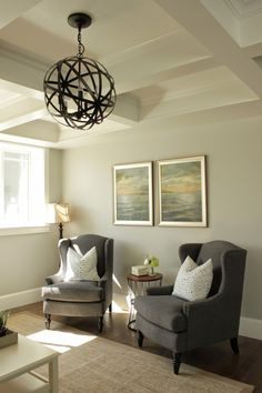 Living Room.  Sitting Area.  Wing Back Chairs.  Orb Chandelier.  Coffered Ceiling.  Sherwin Williams Repose Gray.