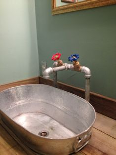 Love this galvanized sink with funky pipe faucet.