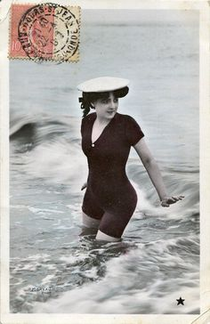 Vintage French hand tinted photo postcard - Lady in the sea wearing a bathing suit