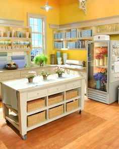 Martha Stewart show craft studio.  Flowers in the cooler, loads of counter space and baskets.  It is perfect.
