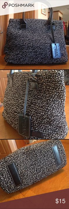 The Sak Elliott Lucca handbag The Sak Elliott Lucca black/white crocheted with black leather details. Zipper for closure. Clean and good condition. The Sak Bags