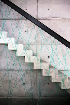 amazing stairs with weird teal stringie thingies as a railing.  Is that glass?  Metal?  Actual rope?