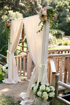 We both love the idea of draping the bridge entrance with a few flower accents