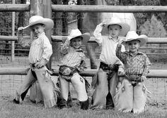 These young 'uns are learning the value of tippin' their hats to the ladies.