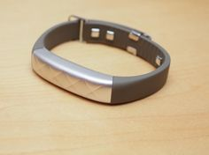 Instead of making a watch, Jawbone has made a heart rate-measuring fashion bracelet...and, a $50 super-affordable fitness tracker. Hands-on with both.